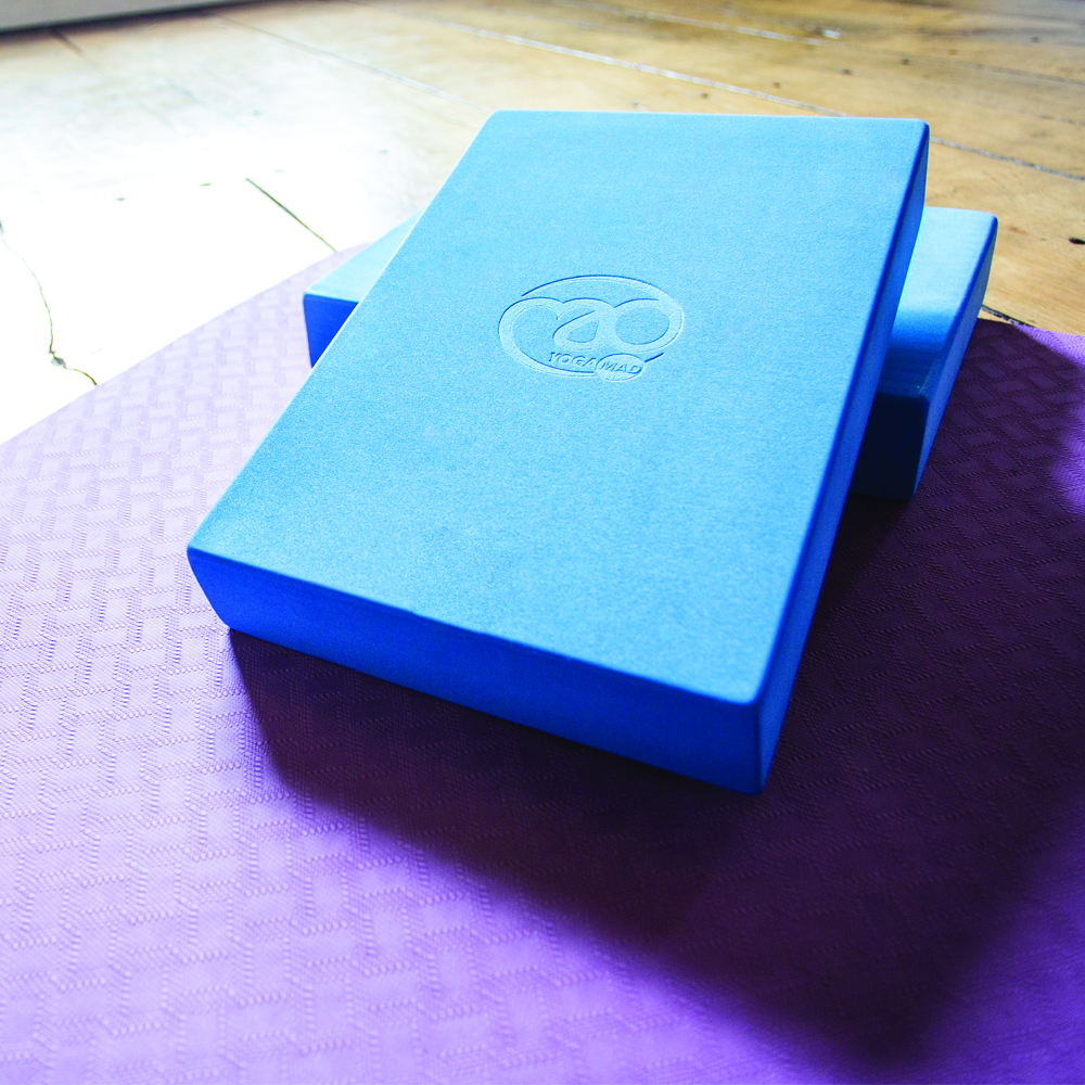 A pair of yoga blocks on a yoga mat
